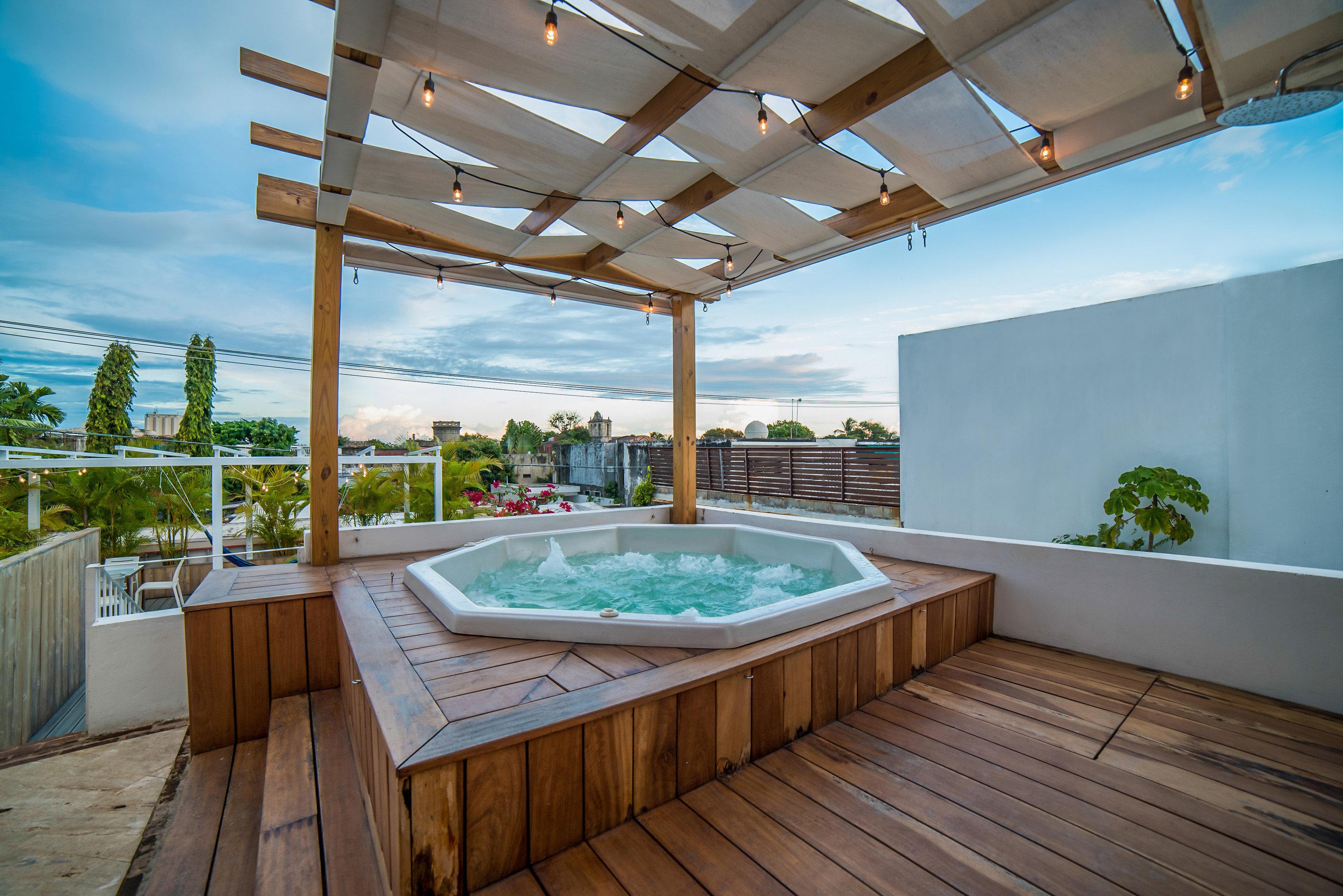 Hotels floor indoor swimming pool property building ceiling room estate real estate Resort Villa interior design backyard Deck wood
