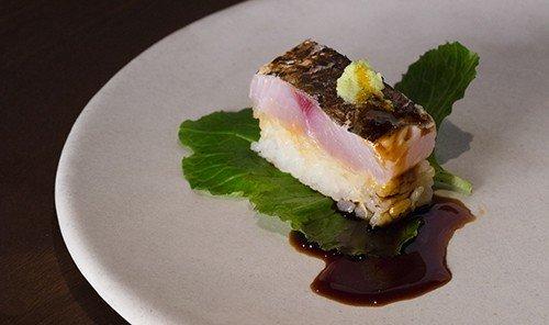 Food + Drink plate table food piece dish cuisine slice produce asian food sushi dessert sandwich half snack food eaten