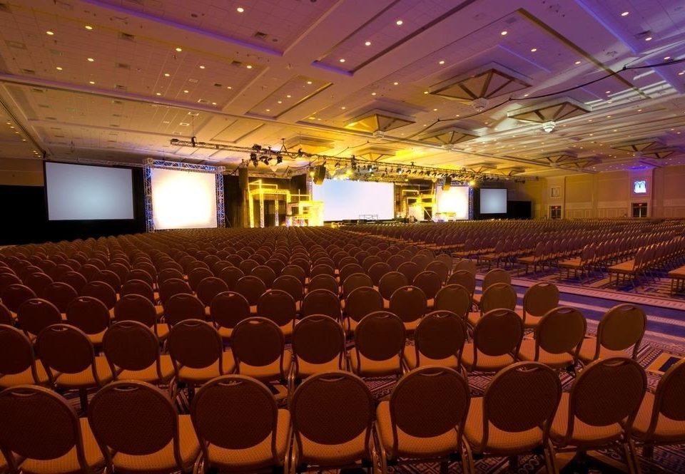 auditorium chair function hall conference hall performing arts center audience stage convention theatre convention center ballroom movie theater academic conference conference room