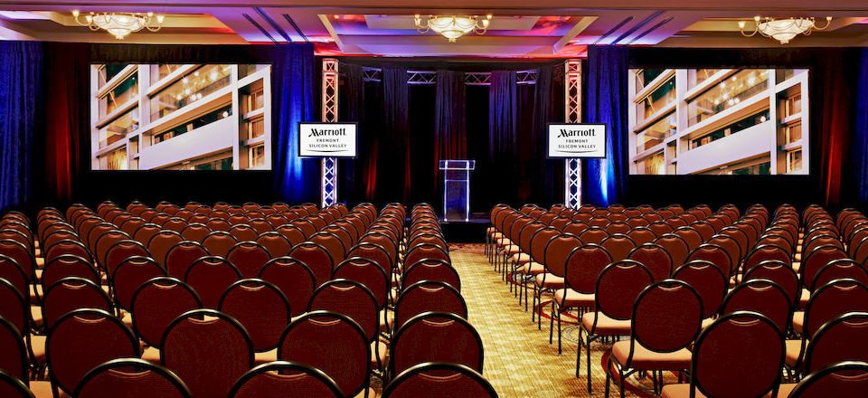 chair auditorium function hall audience conference hall stage convention academic conference ballroom theatre movie theater convention center banquet hall conference room