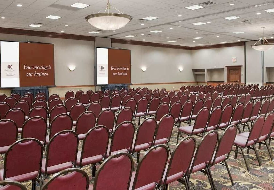 auditorium chair conference hall function hall meeting convention convention center audience academic conference hall lined line