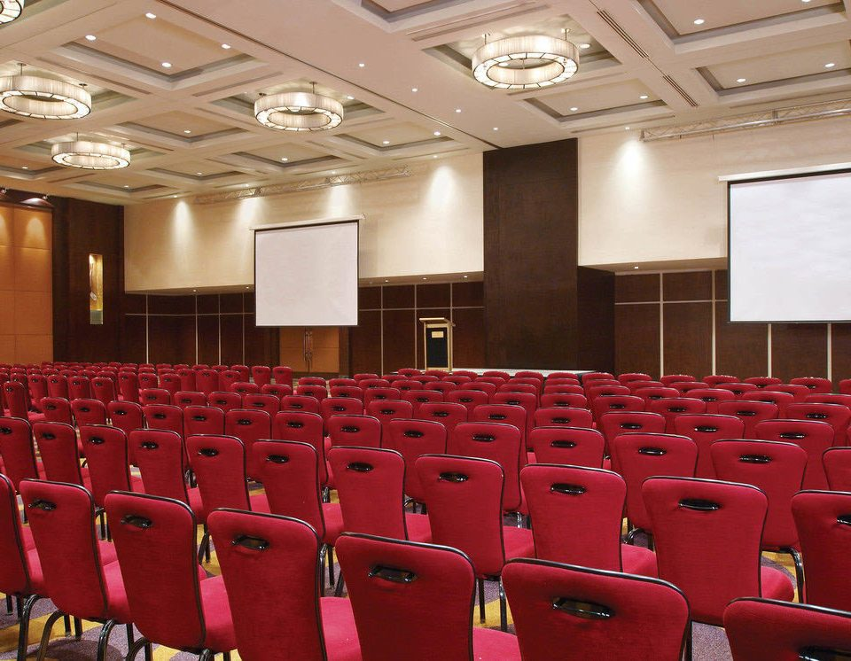 auditorium chair red conference hall function hall convention center convention meeting ballroom theatre academic conference hall