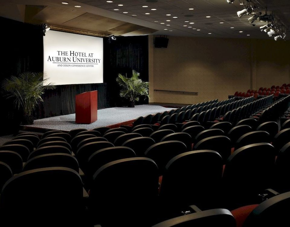 auditorium stage conference hall theatre movie theater academic conference function hall convention dark conference room