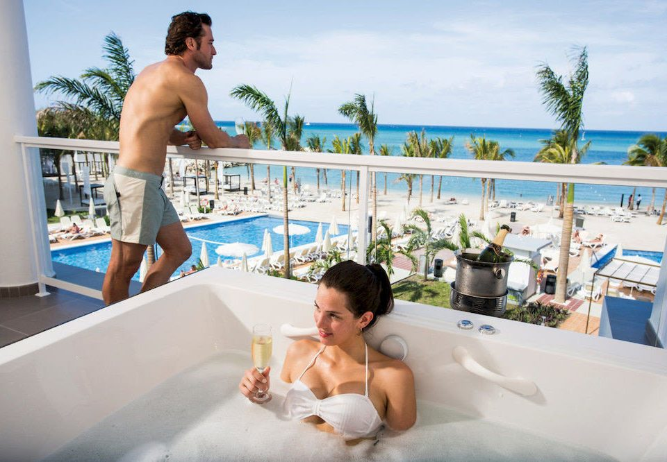 Adult-only All-inclusive Balcony Hot tub/Jacuzzi Scenic views vessel sky swimming pool leisure caribbean tub Water park bathtub Bath