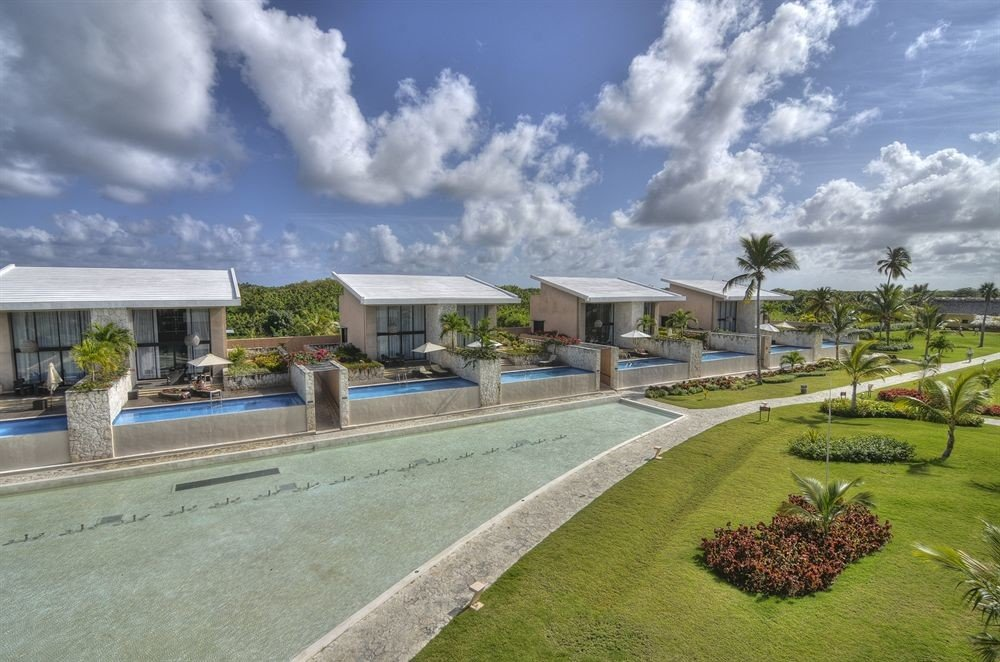 Adult-only All-inclusive Beach Beachfront Lounge Ocean Pool grass sky property residential area home suburb mansion Resort condominium Villa lawn sign