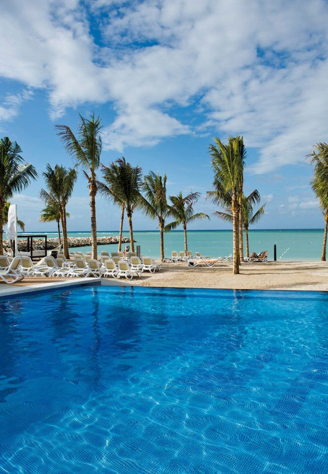 Adult-only All-inclusive Beach Beachfront Grounds Pool sky water swimming pool caribbean Ocean Sea Resort arecales Lagoon blue tropics swimming shore lined day