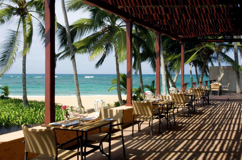 Adult-only All-inclusive Beachfront Dining Honeymoon Romance tree water chair umbrella Beach leisure Resort caribbean lawn restaurant Ocean palm Pool Villa porch Deck set overlooking lined shade