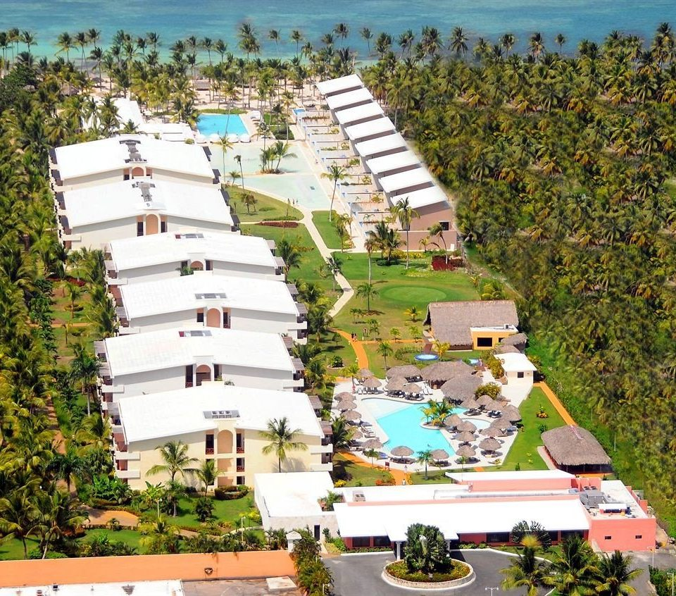 Adult-only All-inclusive Beach Beachfront Lounge Ocean Pool tree property residential area Town neighbourhood Resort condominium bird's eye view aerial photography marina suburb dock urban design Village