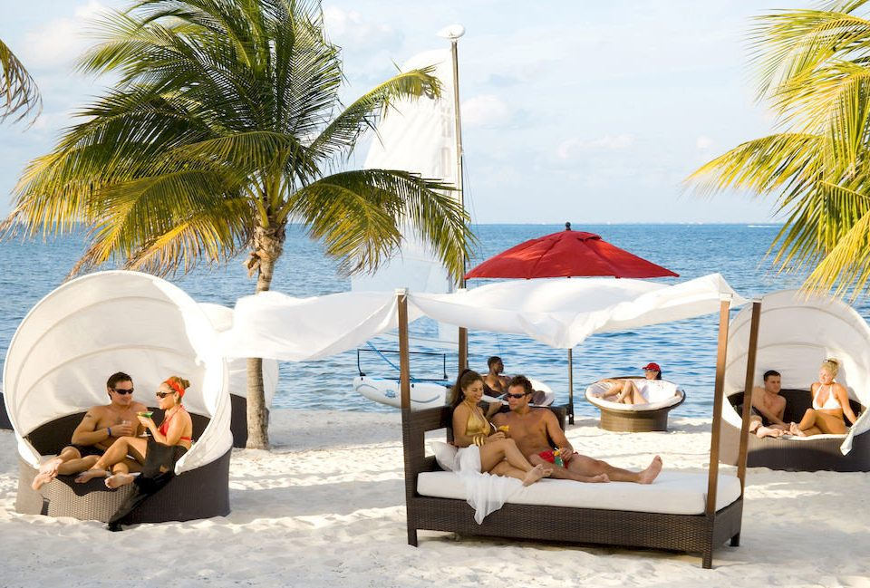 Adult-only All-inclusive Lounge Modern Ocean Waterfront tree leisure palm Beach plant shade sandy Resort