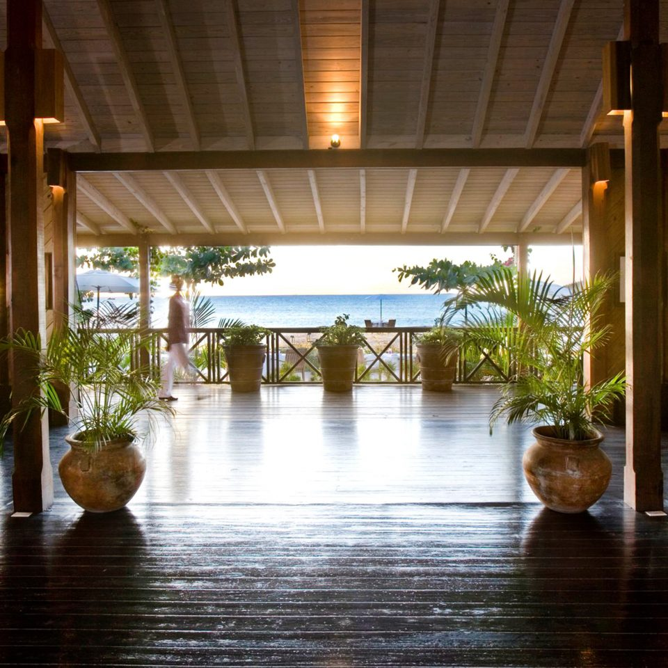 Adult-only All-inclusive Beachfront Eco Lobby Luxury Romance Romantic Resort building home wooden porch Dining eco hotel cottage Villa Courtyard restaurant mansion backyard outdoor structure