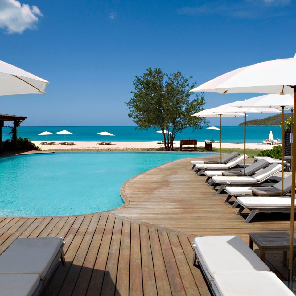 Adult-only All-inclusive Beachfront Eco Grounds Luxury Play Pool Romance Romantic sky chair water umbrella leisure swimming pool Resort lawn marina dock accessory caribbean Deck Sea vehicle Villa Nature yacht shore swimming lined day