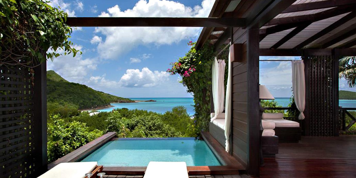 Adult-only All-inclusive Beachfront Eco Hotels Luxury Play Pool Romance Romantic Travel Tips leisure property swimming pool building house Villa home Resort cottage backyard condominium Deck
