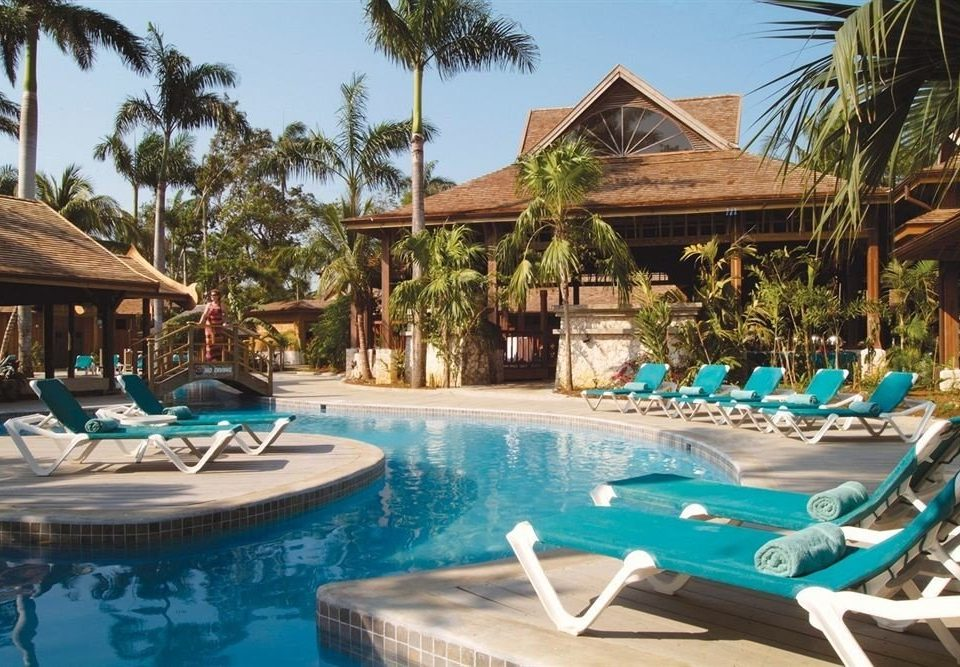 Adult-only All-inclusive Beachfront Pool Tropical tree swimming pool leisure Resort property chair caribbean Villa resort town blue eco hotel lined swimming