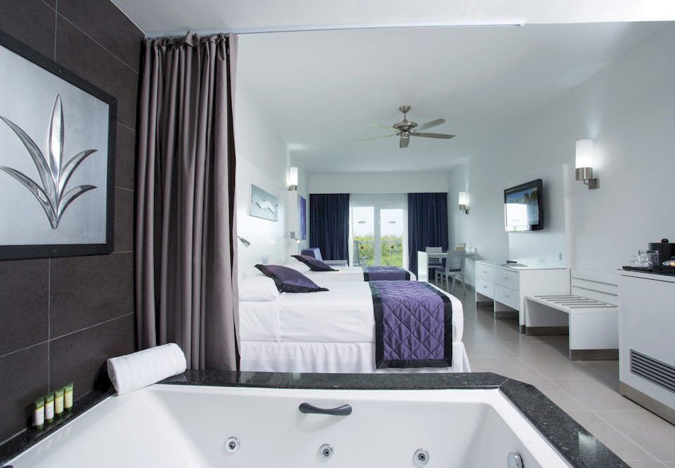 Adult-only All-inclusive Bedroom property home bathroom living room white Suite