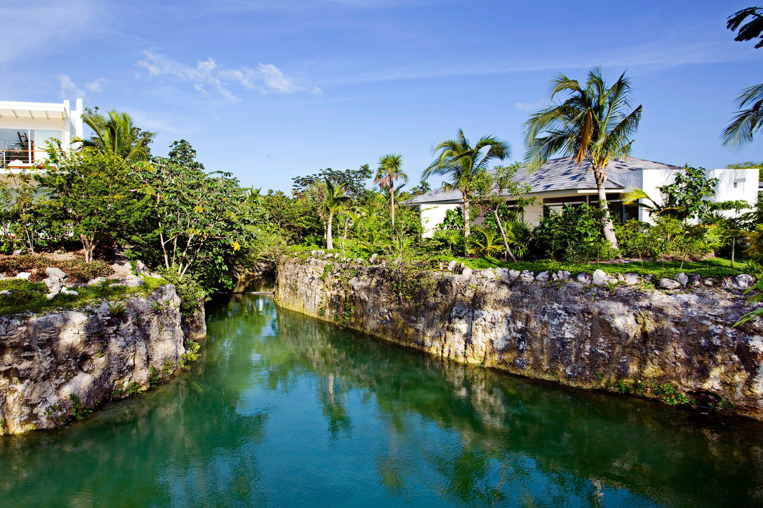 Adult-only All-inclusive Grounds Luxury Wellness water tree Nature River Sea arecales flower tropics Coast waterway pond surrounded