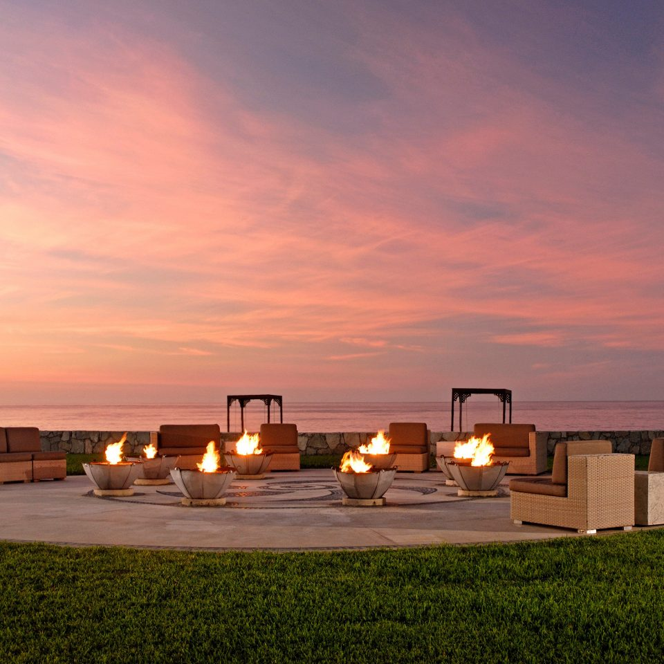 Adult-only All-inclusive Firepit Honeymoon Hotels Romance Romantic Tropical Waterfront sky grass horizon Sunset dusk evening sunrise morning dawn sunlight lighting Sea