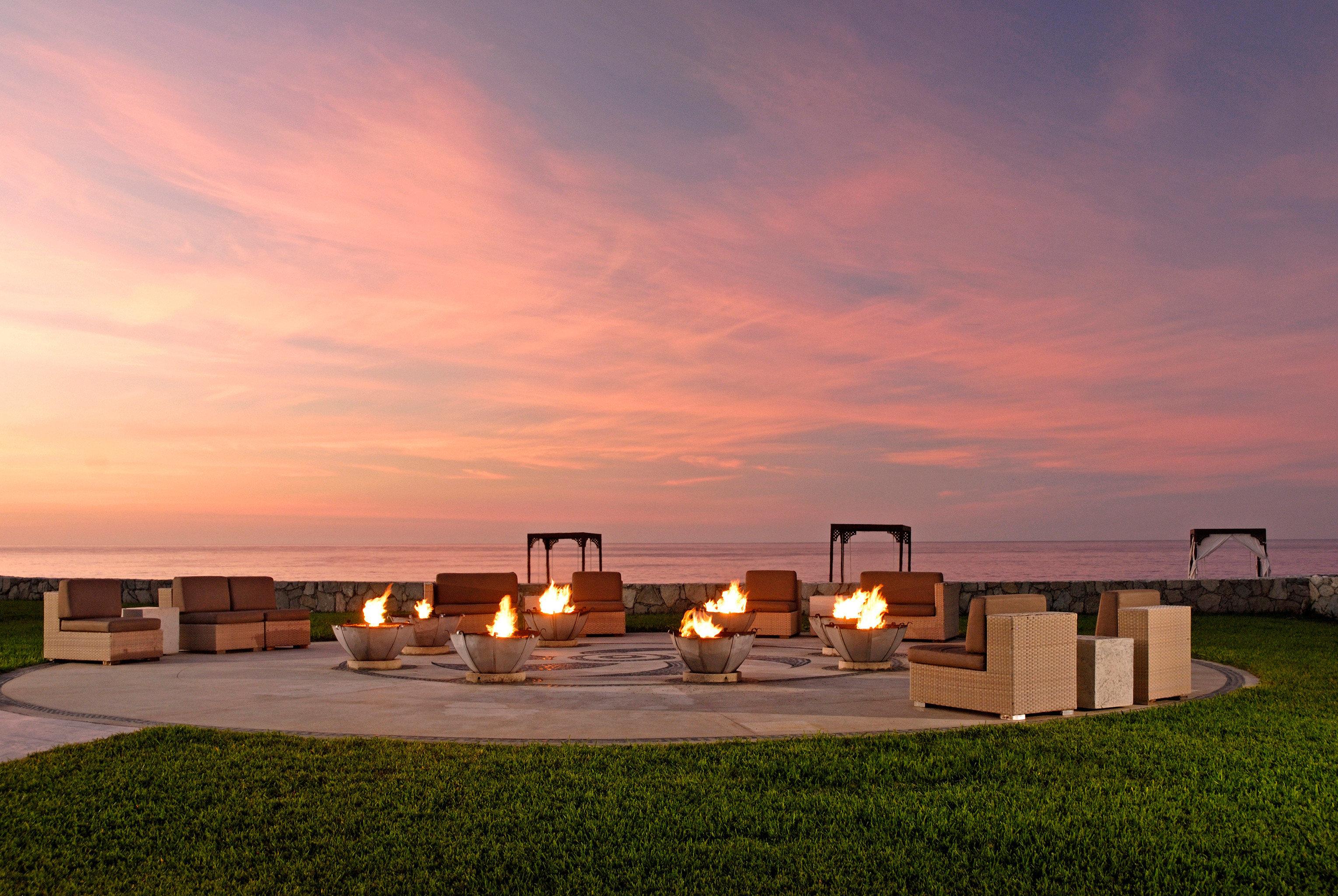 Adult-only All-inclusive Firepit Honeymoon Hotels Romance Romantic Tropical Waterfront sky grass horizon Sunset dusk evening sunrise morning dawn sunlight lighting Sea