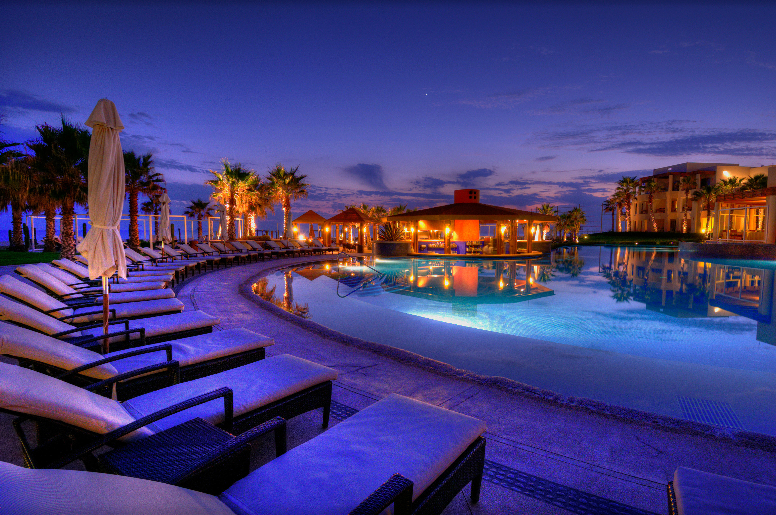 Adult-only All-inclusive Honeymoon Hotels Pool Romance Romantic Tropical Waterfront sky scene night swimming pool evening Resort dusk cityscape Sunset