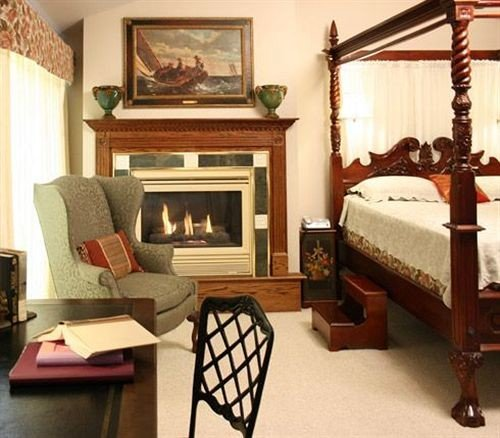 Adult-only B&B Bedroom Fireplace Historic Inn property living room home hardwood cottage Suite