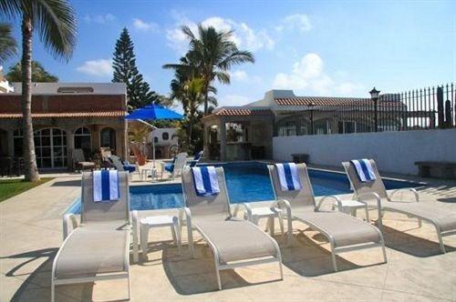 Adult-only B&B Pool sky chair property Resort condominium swimming pool marina Villa palm Deck