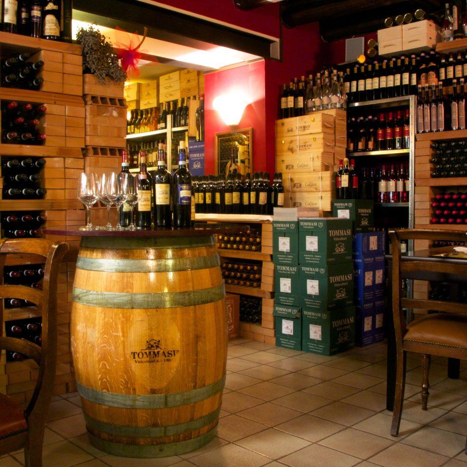 Adult-only Cultural Drink Nightlife man made object Bar restaurant liquor store beer café basement