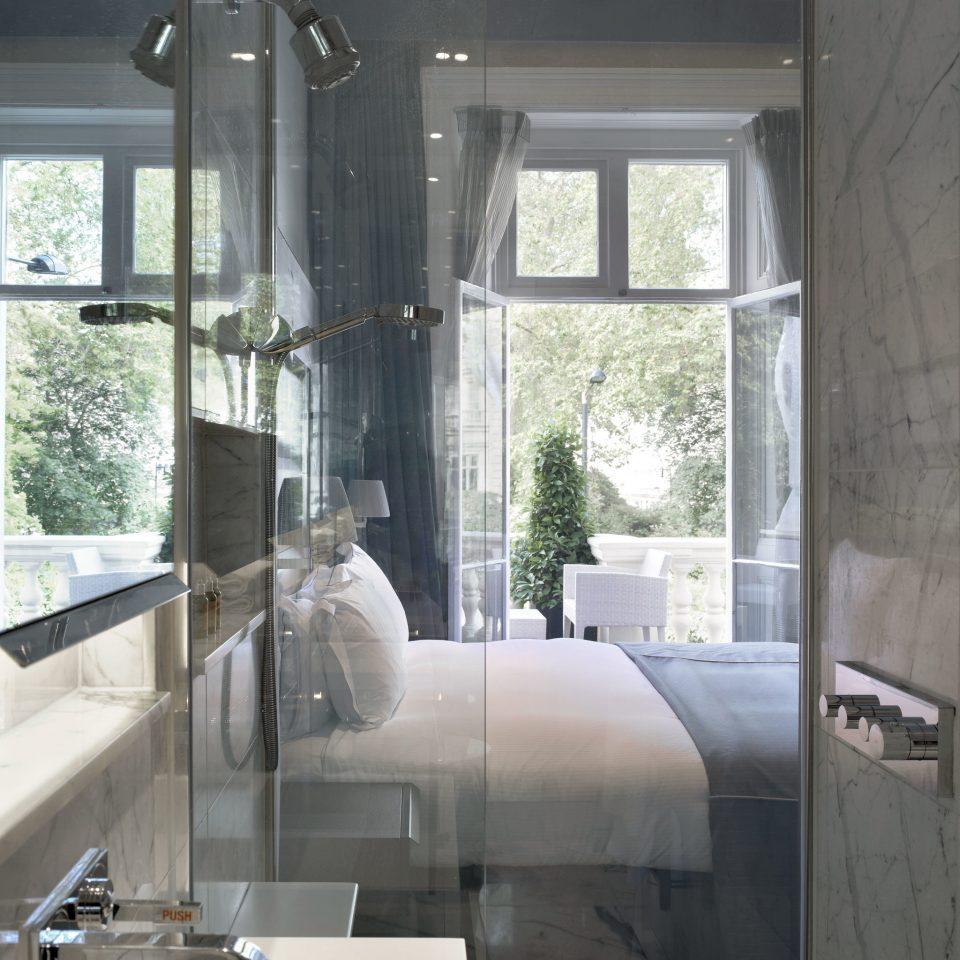 Adult-only Bedroom Modern bathroom property house sink home daylighting plumbing fixture condominium tub Bath tiled bathtub tile