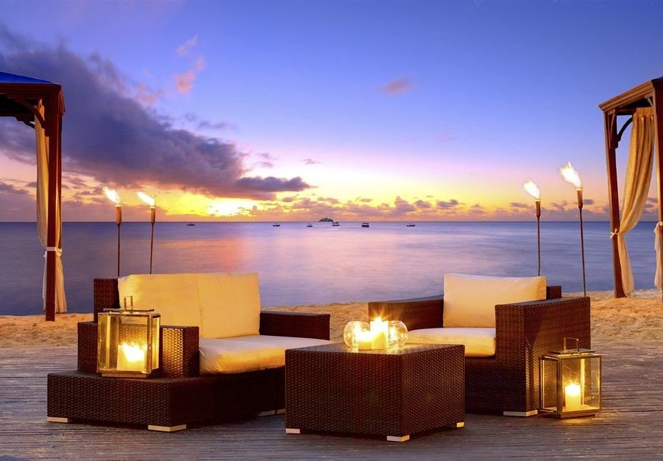 Adult-only Beach Beachfront Lounge Luxury Ocean sky water chair evening Sunset morning lighting Sea dusk overlooking