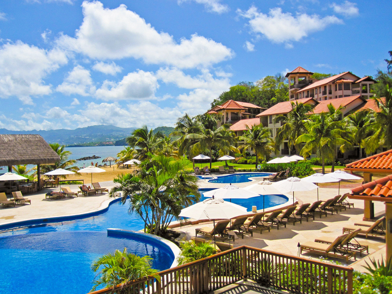Adult-only Beach Eco Grounds Island Pool Scenic views Villa Waterfront sky umbrella Resort swimming pool leisure property caribbean blue resort town Water park Village Lagoon swimming lined day