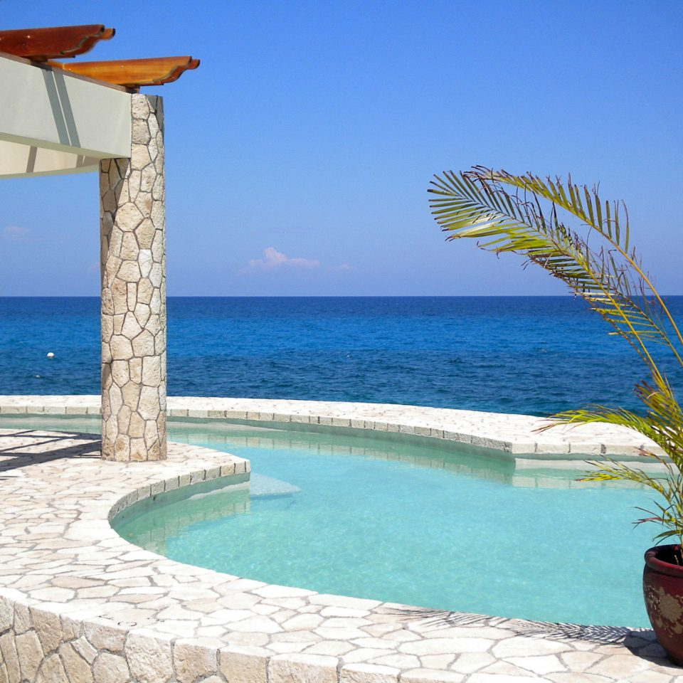 Adult-only Grounds Pool Spa Wellness water sky Ocean swimming pool Beach property caribbean Villa Sea Resort condominium sunny shore overlooking swimming sandy day
