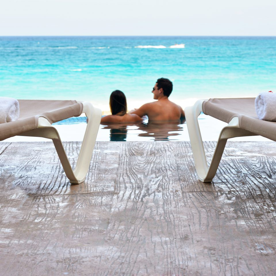 Adult-only Beach Lounge Ocean Play sky water ground human positions sitting leisure sun tanning leg chair shore sandy
