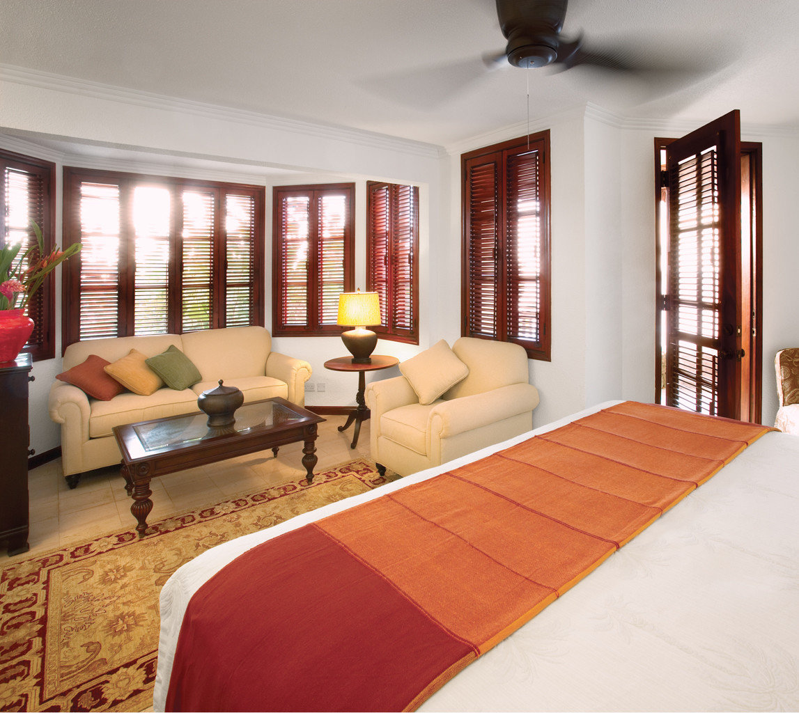Adult-only Bedroom Classic Island Scenic views Waterfront property living room home hardwood Suite cottage flooring wood flooring Villa