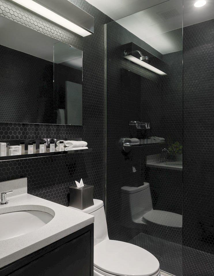 Adult-only Boutique City bathroom sink mirror toilet lighting white plumbing fixture bidet flooring Suite tile
