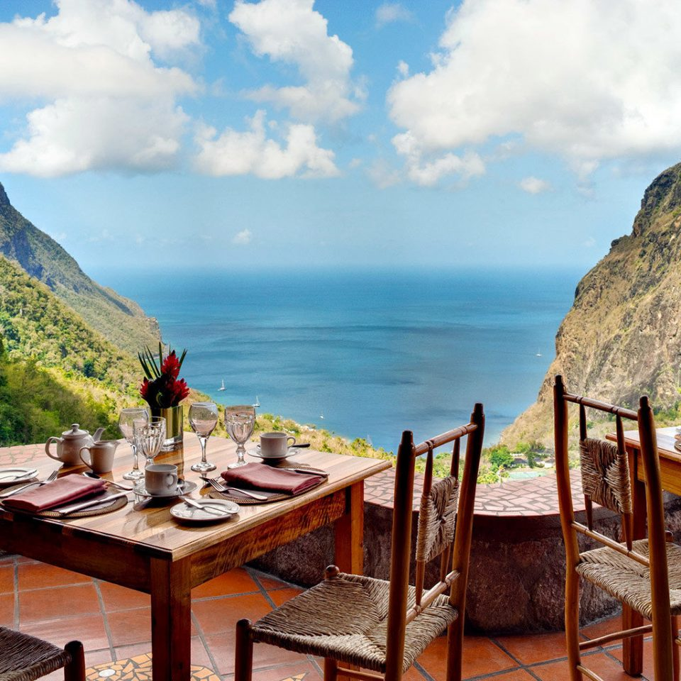 Adult-only Dining Drink Eat Food + Drink Honeymoon Hotels Luxury Luxury Travel Resort Romance Scenic views Trip Ideas mountain sky chair leisure Nature Sea Coast travel overlooking set Island
