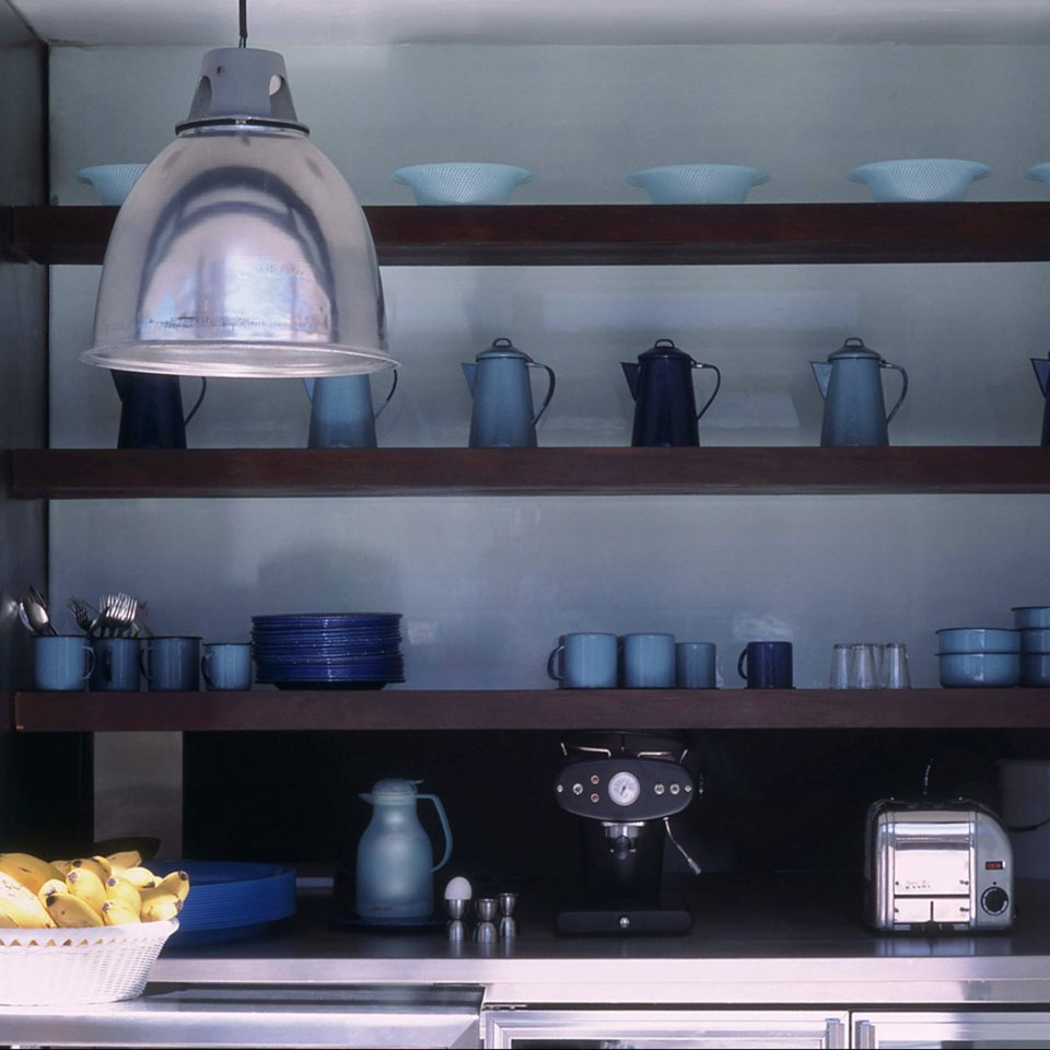 Adult-only Kitchen Modern shelf shelving cabinetry lighting living room counter hearth kitchen appliance