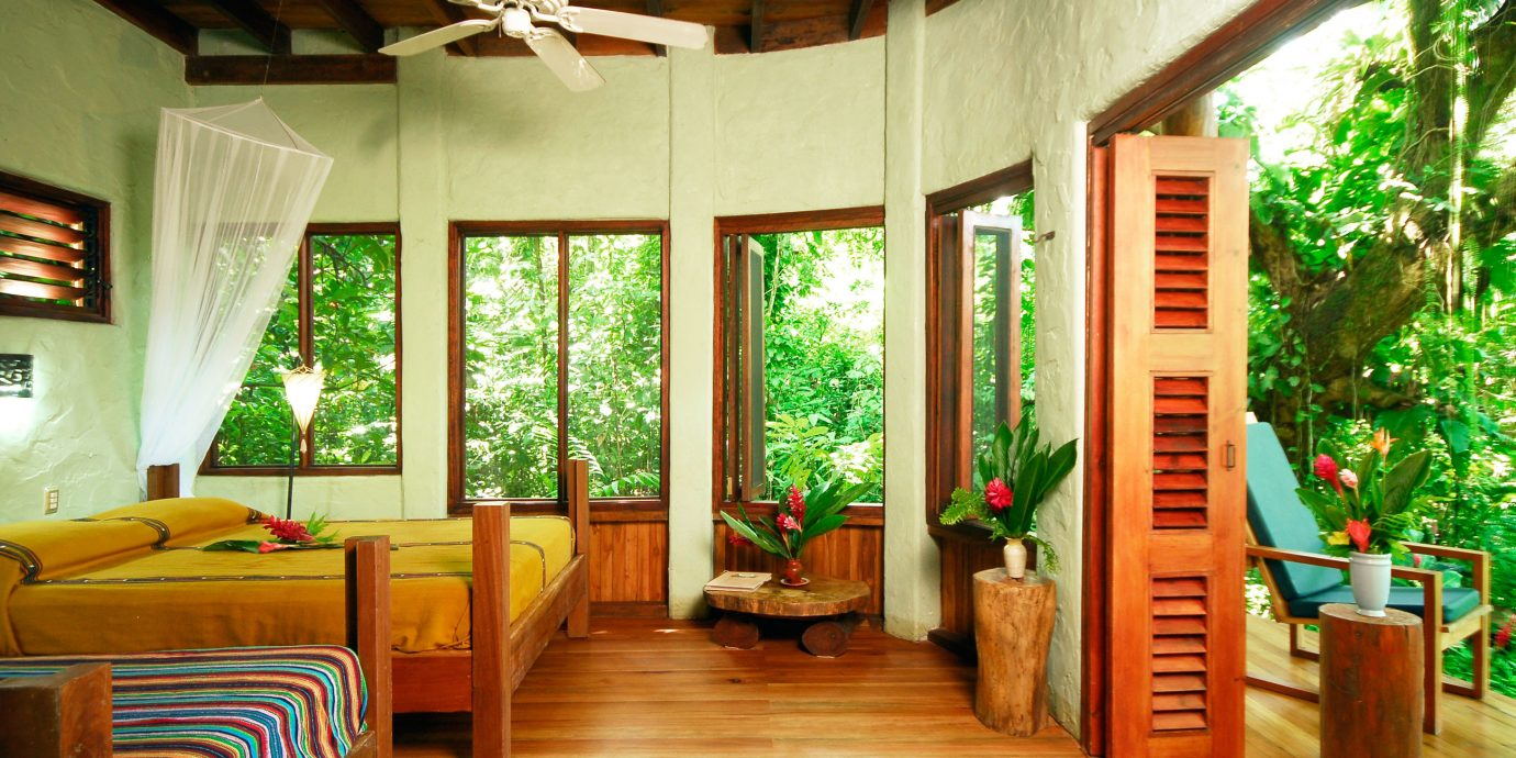 Adventure All-inclusive Balcony Bedroom Eco Honeymoon Jungle Outdoor Activities Outdoors Romantic Rustic Scenic views Suite property house porch Resort home cottage log cabin living room Villa outdoor structure farmhouse hard
