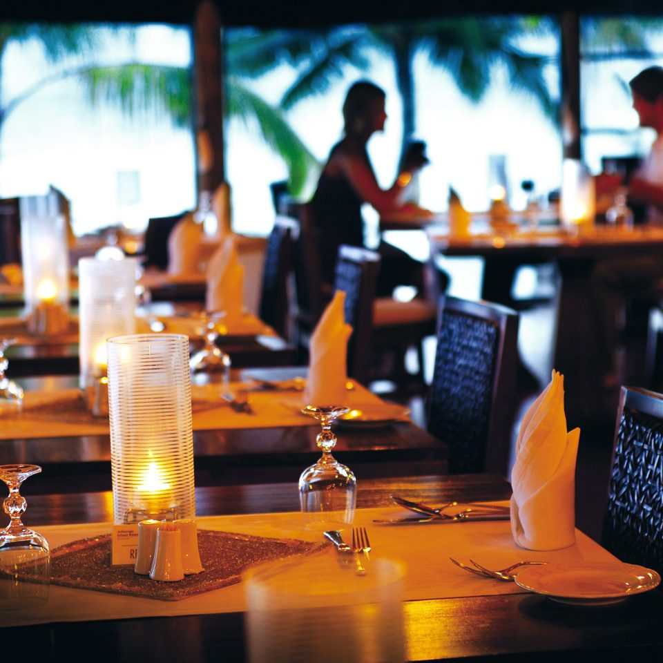 Adventure All-inclusive Beachfront Dining Drink Eat restaurant Bar dining table