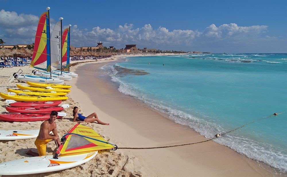 Adventure All-inclusive Beach Budget Family Outdoor Activities Resort Sport Tropical Waterfront sky water Sea vehicle boating sailing Boat shore Coast windsurfing Nature surfboard caribbean surfing equipment and supplies sports sand sea kayak paddle cape wave sandy