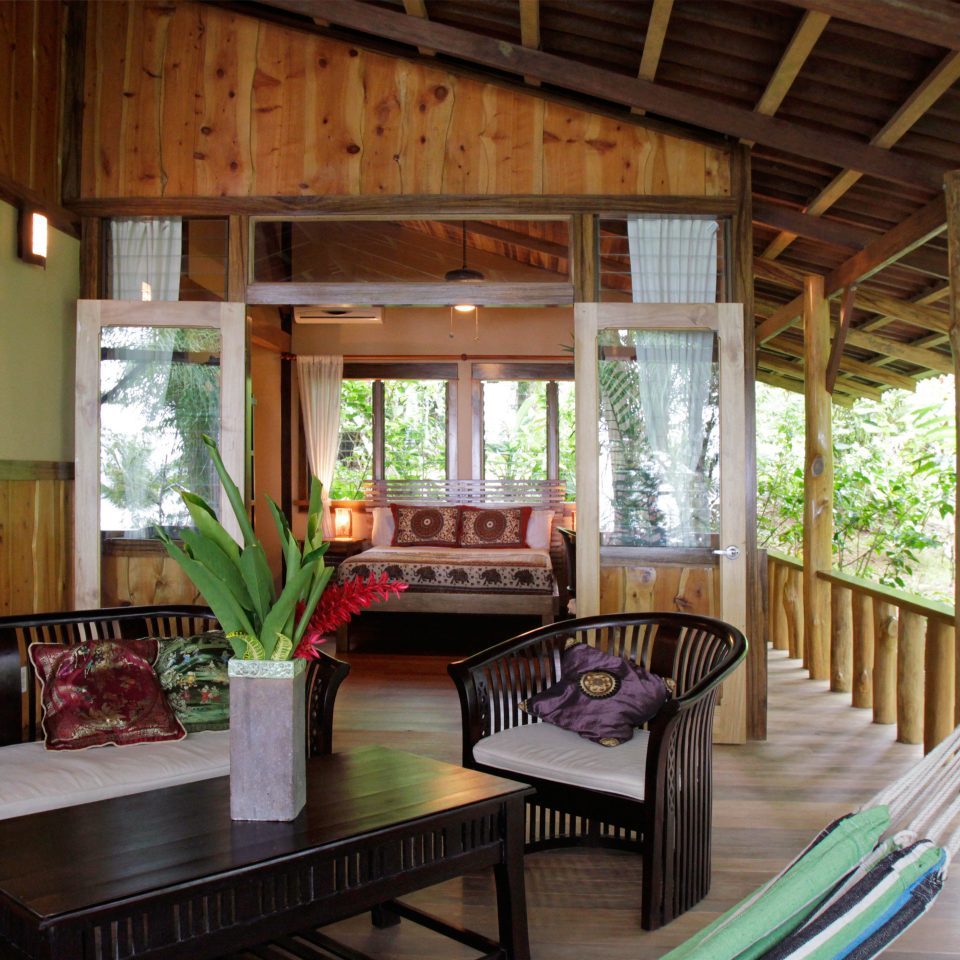 Adventure Balcony Bedroom Eco Jungle Outdoor Activities Rustic Wellness property house home cottage porch living room Resort Villa farmhouse outdoor structure wooden Dining log cabin