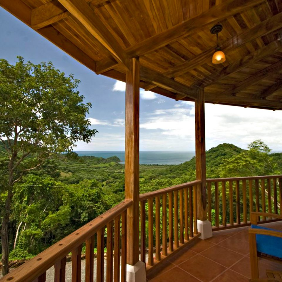 Adventure Balcony Country Eco Honeymoon Romantic Rustic Scenic views Wellness tree building chair porch property house wooden Resort home cottage Villa outdoor structure backyard Deck overlooking