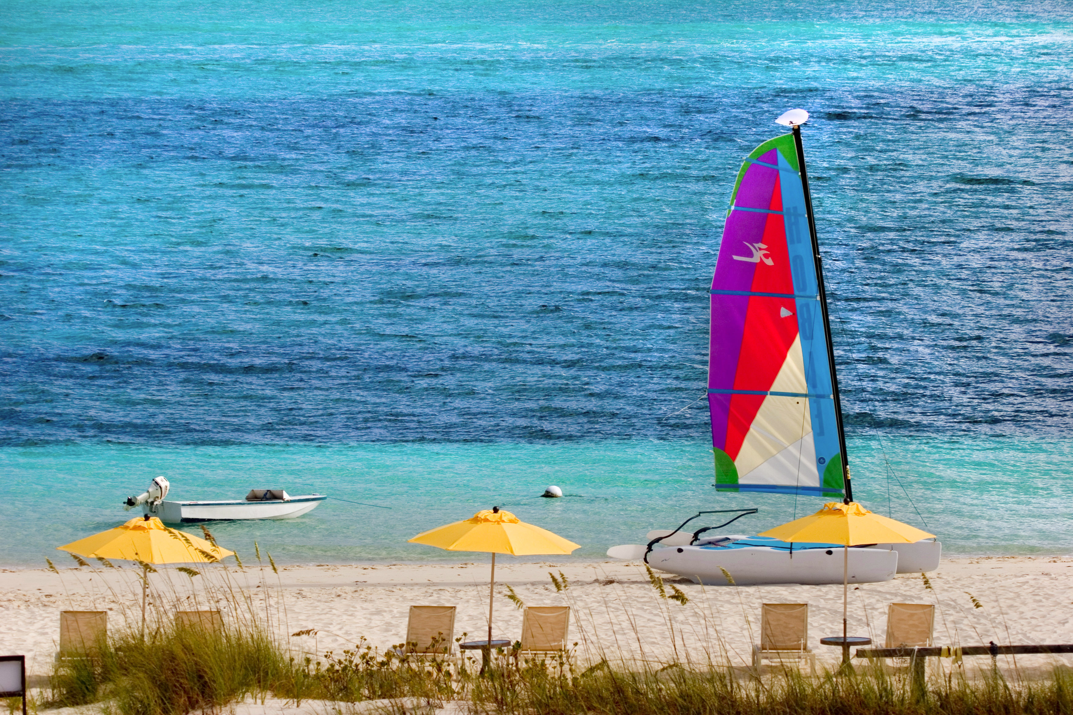 Adventure Beach Beachfront Boat Ocean water Sea vehicle sail yellow sailboat watercraft sailing sports windsurfing boating Coast wind surfing equipment and supplies shore lined day