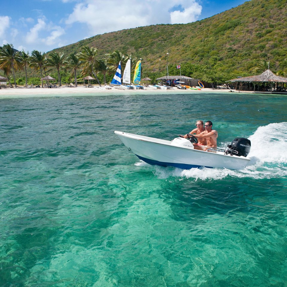 Adventure Beach Beachfront Boat Honeymoon Luxury Outdoors Play Scenic views water mountain Sea Nature boating vehicle Ocean wind wave wave reef caribbean surfboard surfing equipment and supplies Coast sports Island Lagoon paddle