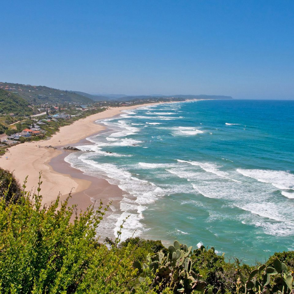 Adventure Beach Beachfront Nature Ocean Outdoors water sky Coast shore Sea horizon cliff cape terrain cove wave overlooking