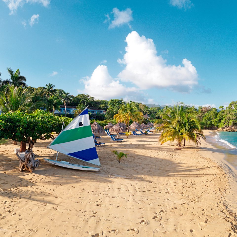 Adventure Beach Beachfront Luxury Ocean Outdoors Resort sky water ground shore leisure caribbean Sea Coast Nature tropics Island Lagoon cape sand arecales cove sunny day sandy