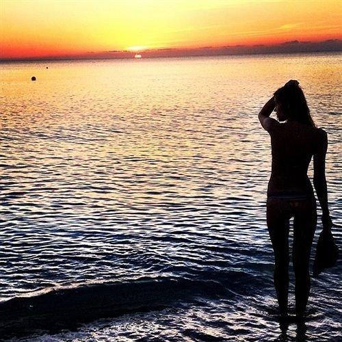Adventure Beach Beachfront Lounge Luxury Ocean Play water sky woman standing Sea Sunset horizon shore Coast morning sunlight wave sunrise dusk sand silhouette