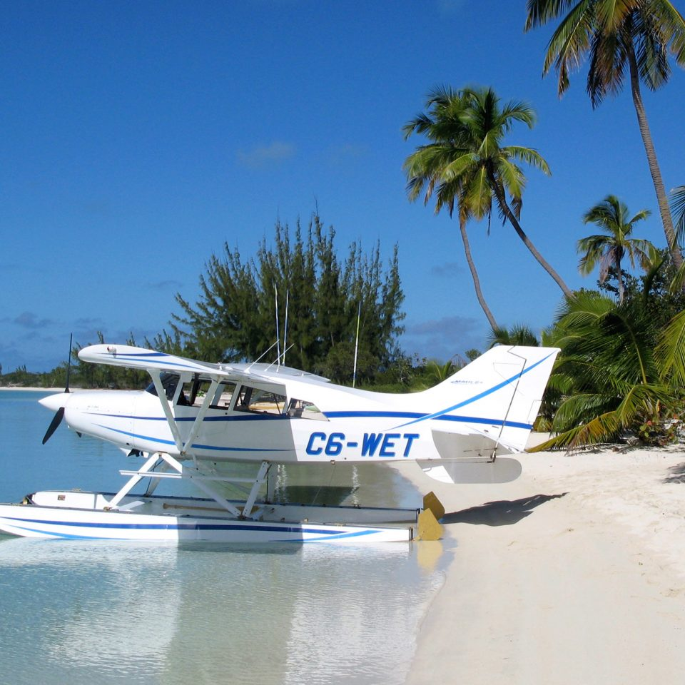 Adventure Beach Beachfront Eco Outdoor Activities Resort Romance Scenic views tree sky water airplane vehicle aircraft aviation atmosphere of earth Sea light aircraft palm caribbean landing