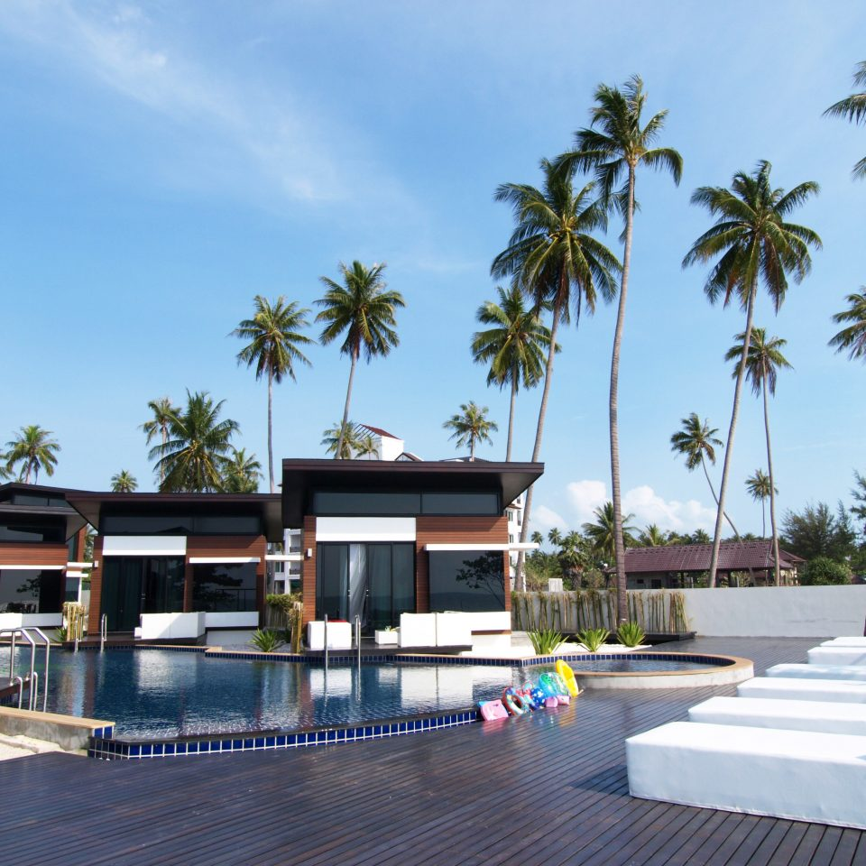 Adventure Beach Beachfront Lounge Ocean Outdoors sky tree palm leisure property Resort swimming pool condominium plaza home Villa marina walkway sign