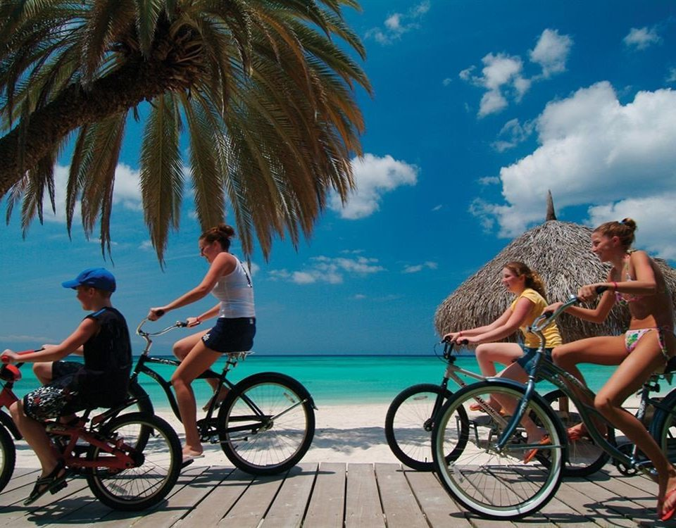 Adventure Beach Beachfront Ocean Outdoor Activities Outdoors Sport sky leisure vehicle cycling endurance sports shore