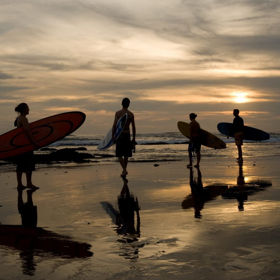 Adventure Ocean Outdoor Activities Outdoors Sea Sport Tropical Wellness sky water Beach Sunset morning Boat evening silhouette vehicle surfboard dusk surfing equipment and supplies paddle dawn sunrise wave shore sandy