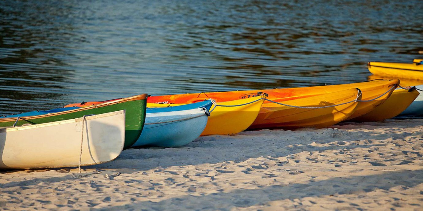 Adventure Beach Outdoors water Boat vehicle kayak boating watercraft rowing canoe Sea watercraft sports equipment kayaking paddle sea kayak surfing equipment and supplies dinghy orange sand