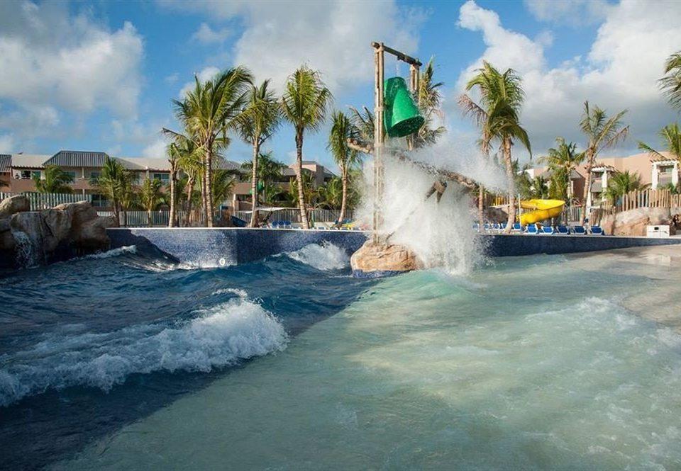 Adventure Family Play Pool Resort Tropical sky Sea water Ocean Water park Coast Beach amusement park water feature Nature park wave tropics Lagoon cape cove